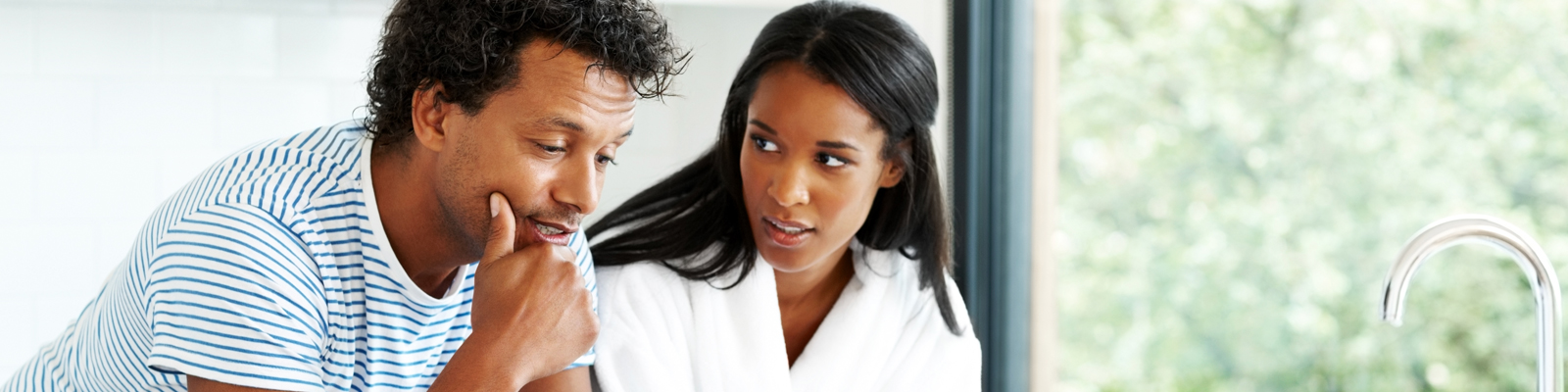 An African American couple thinking while having a discussion